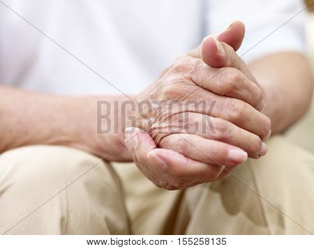 close-up of a pair of senior male's hands side view