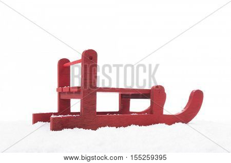 Red wooden sled in the snow