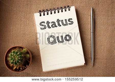 status quo text message on white paper