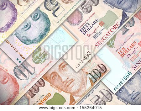 Different money bills stacked over each other forming a money background.