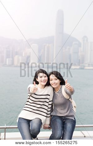 two beauty woman smile and thumb up in hongkong