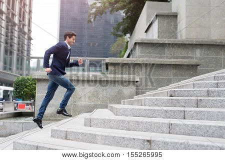 Businessman in hurry. Motion blurred people over office building in hongkong