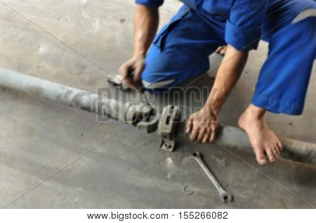 Mechanic fixing the rear axle of the truck