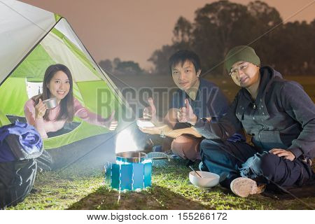 people are camping outdoor with tent asian