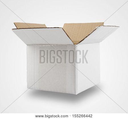 Open cardboard box on plain background