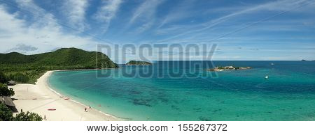 Island, clear seawater and blue sky background
