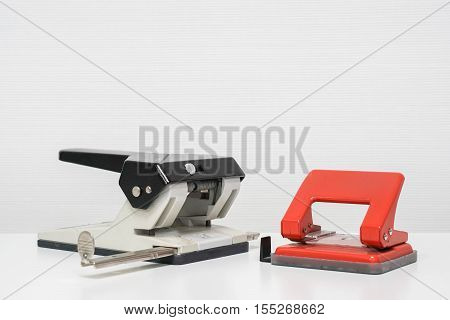 isolated paper punch in white and red color on table