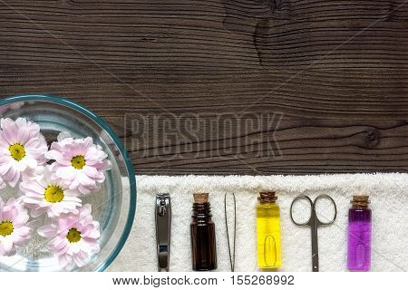 care of nails and cuticle on dark wooden background top view.