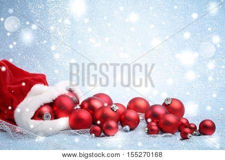 Santa Claus red bag with Christmas balls.