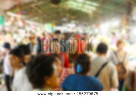 Blur of shopping people in the market for design background in your business.