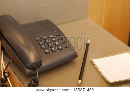 Phone and notes in a hotel room
