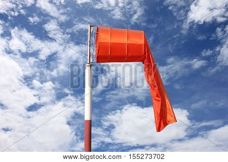 Wind sock of equipment check the wind blow direction in day time on blue sky background.