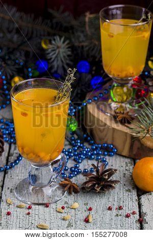 hot berry tea with a fresh sea-buckthorn