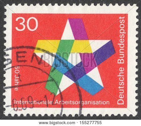 MOSCOW RUSSIA - CIRCA OCTOBER 2016: a post stamp printed in GERMANY dedicated to the 50th anniversary of the International Labor Organization circa 1969