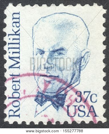 MOSCOW RUSSIA - CIRCA OCTOBER 2016: a post stamp printed in the USA shows a portrait of Robert Millikan the series