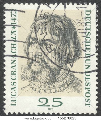 MOSCOW RUSSIA - CIRCA OCTOBER 2016: a post stamp printed in GERMANY dedicated to the 500th Anniversary of the Birth of Lucas Cranach Painter and Lithographic Artist circa 1972