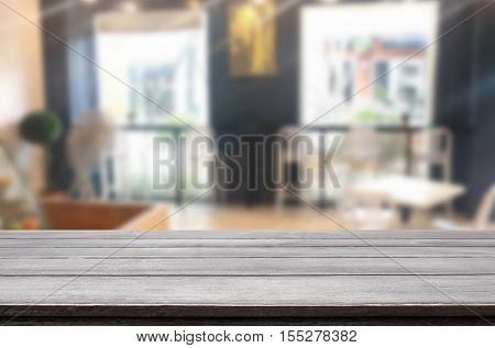 Selected Focus Empty Brown Wooden Table And Coffee Shop Blur Background With Bokeh Image. For Your P