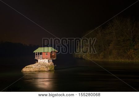 Night view of Lonely house on the river Drina in Bajina Basta in Serbia