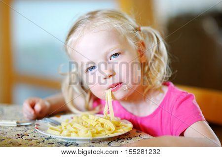 Cute Funny Little Girl Eating Spaghetti