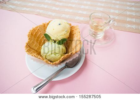 Homemade ice cream scoops in waffle bowl stock photo