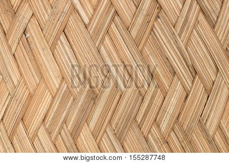 traditional thai style pattern nature background of brown handicraft weave texture bamboo surface for furniture materia poster