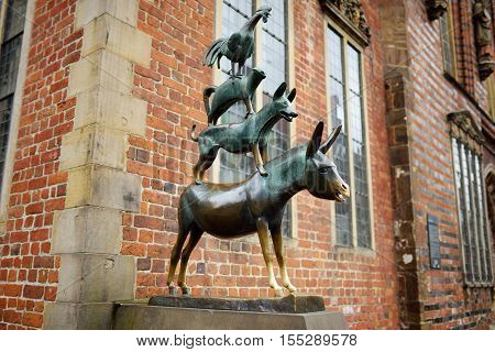 BREMEN GERMANY - MARCH 23 2016: Famous statue in the center of Bremen depicting the donkey dog cat and cockerel from Grimm's famous fairy tale The Bremen Town Musicians