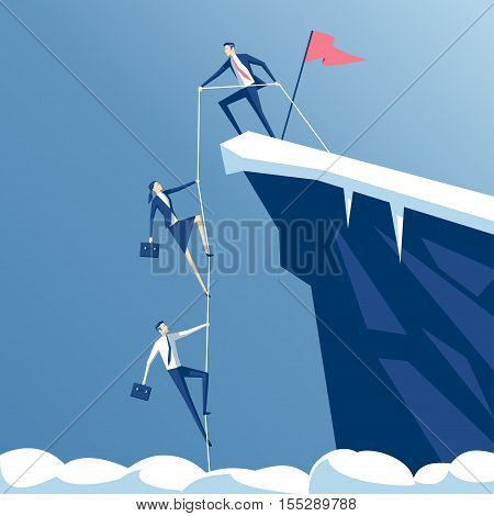 leader helps the team climb to the top of the rock a businessman with a rope pull teammates to the top of the mountains business concept teamwork and leadership
