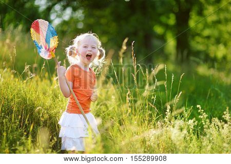 Cute Little Girl Catching Butterflies And Bugs With Her Scoop-net