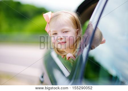 Funny Little Girl Is Sticking Her Head Out The Car Window