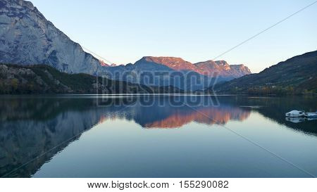 Reflection Of Mountains In Water Of Lago Cavedine