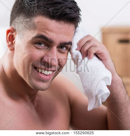 Man Using The Towel To Dry His Body