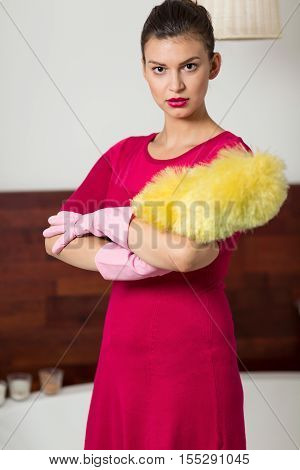 Woman Holding A Dust Brush
