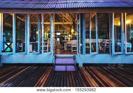 Front view wooden bar & restaurant at tropical beach