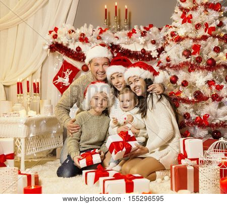 Christmas Family Portrait Xmas Tree Presents Gifts Happy Family Celebration in Holiday Decorated Room