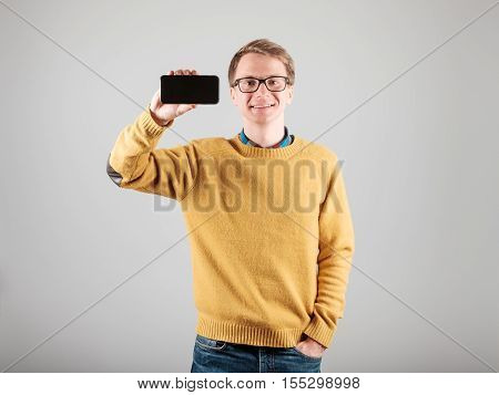 Man Showing Blank Screen Of His Phone