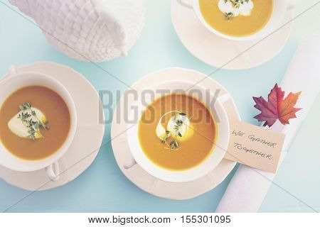 Traditional Thanksgiving Pumpkin Soup On Pale Blue Table.