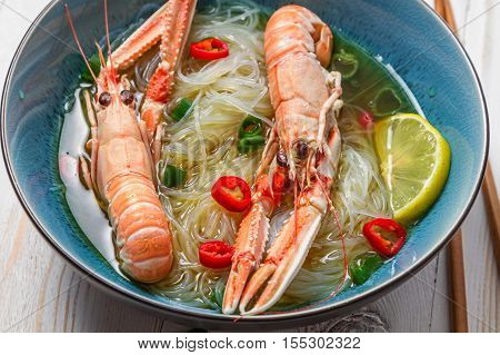 Traditional Thai Soup With Scampi And Noodles