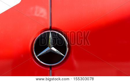 STRASBOURG FRANCE - JUN 24 2016: Mercedes-Benz steel brand logo on a red van. Mercedes-Benz is a global automobile manufacturer and a division of the German company Daimler AG
