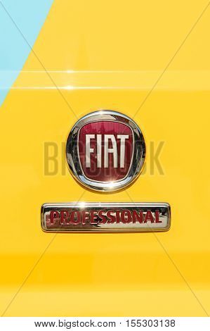 TURIN ITALY - CIRCA 2016: Fiat Professional sign on the yellow delivery van - light commercial vehicle. Fiat Professional is the brand name and subsidiary for FCA Italy's (formerly Fiat Group Automobiles) light commercial vehicles and their passenger vari