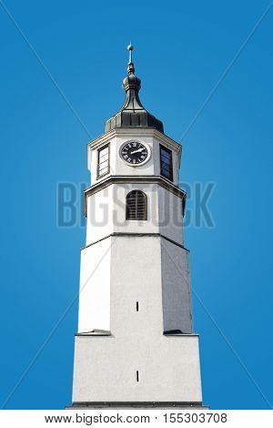 Tower Clock Standing Tall On The Blue Background
