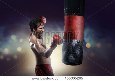 Athletic Asian Boxer Training Uppercut With Punching Bag