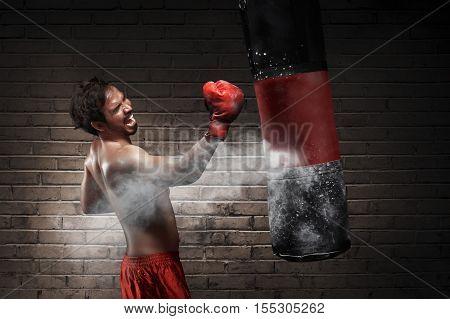 Asian Male Athlete Boxer Training Uppercut