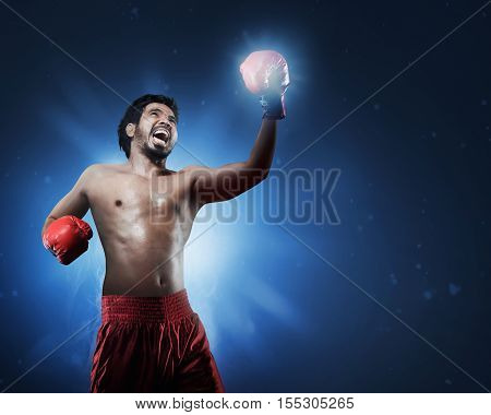Aggressive Asian Man Boxer With Gloves Training Throwing Punch