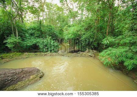 Wonderful wooden bridge across a waterfall, Kalasin, Thailand