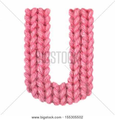 Letter U alphabet on a blurry texture knitted pattern of woolen thread closeup. One letter of the English alphabet. Education and holidays. Typography design. Color rede