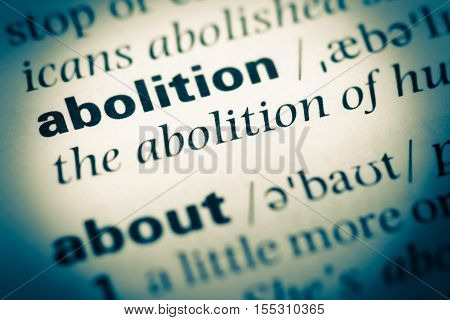Close Up Of Old English Dictionary Page With Word Abolition