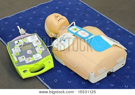 Automated External Defibrillator with training dummy mannequin poster