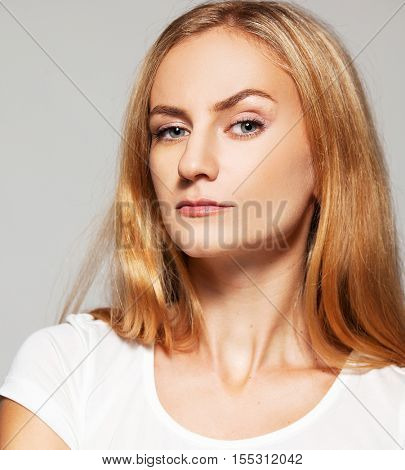 Woman with a raised eyebrow. Female