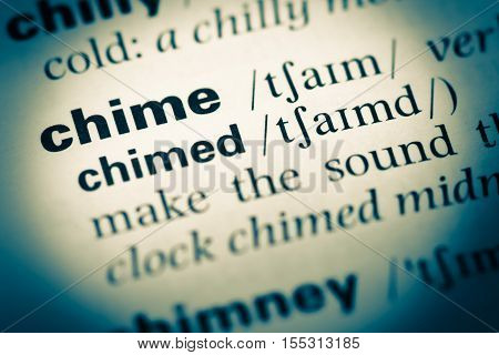 Close Up Of Old English Dictionary Page With Word Chime