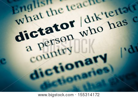 Close Up Of Old English Dictionary Page With Word Dictator